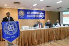 CA Devendra Jain, Chairman welcoming speakers and members. Seen from L to R: Dr. K. Shivaram, Faculty, CA Hinesh R. Doshi, President, CA, Nimesh Chotani, Convenor