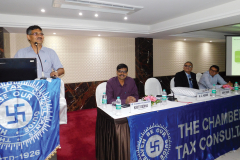 CA N. C Hegde addressing the delegates. Seen from L to R: CA Kirit Dedhia (Vice- Chairman), CA Anish Thacker (Vice-President) and CA Ronak Doshi (Convenor)