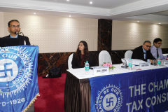 CA Shabbir Motorwala addressing the delegates. Seen from L to R: CA Isha Shekri (Convenor), CA Anish Thacker (Vice- President) and CA Ujwal Thakrar (Member)