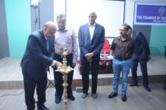 CA Hinesh R. Doshi, inaugurating the meeting by lighting the lamp. Seen from L to R: S/Shri CA Jagdish Punjabi, Faculty, CA H. Padamchand Khincha, Advisor, CA Narendra Jain, Convenor