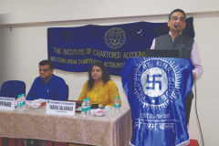 CA Vipul Choksi (President) giving his opening remarks. Seen from L to R: CA Sachin Maher (Speaker) and Ms. Varsha Galvankar (Chairperson)