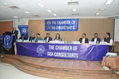 CA Hinesh Doshi (President) giving his opening remarks. Seen from L to R: Mr. Devendra Jain, Advocate, (Chairman); Mr. Ashok Kumar Jha (CIT(A) TDS, Mumbai), Mr. Kumar Sanjay (CIT TDS, Mumbai), Mr. Pratap Singh (CIT (TDS), Mumbai), Ms. Anuradha Bhatia (Principal Chief CIT TDS, Mumbai), Mr. V. K. Gupta (CIT (TDS), Mumbai), Mr. Sunil Sharma (CIT-CPC, Ghaziabad) and CA Dinesh Poddar (Vice-Chairman)